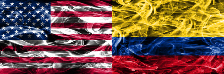 United States vs Colombia smoke flags concept placed side by side