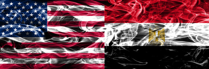 United States vs Egypt smoke flags concept placed side by side