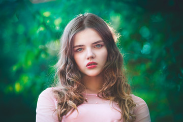 Atmospheric portrait of young beautiful woman, long hair and casual makeup