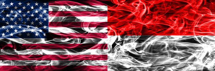 United States vs Indonesia smoke flags concept placed side by side