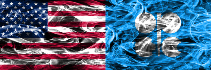 United States vs OPEC smoke flags concept placed side by side