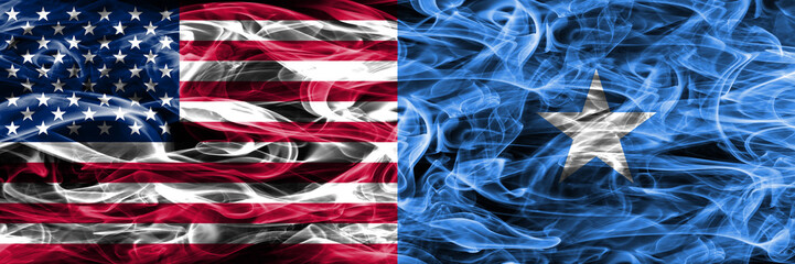 United States vs Somalia smoke flags concept placed side by side