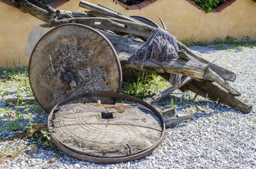 destroyed wooden cart with wooden wheels