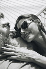 Couple resting together in a hammock