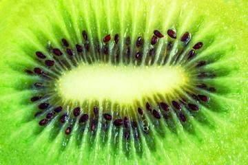 Slice of fresh kiwi fruit isolated on white background.