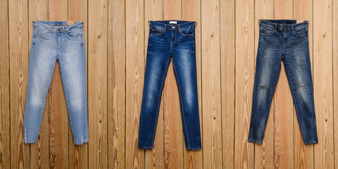 Three Jeans- wooden background