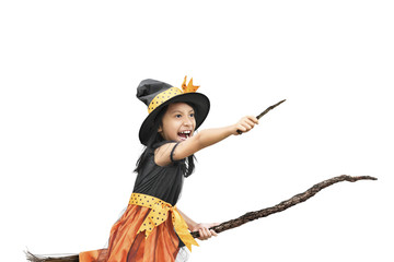 Little asian girl in witch costume using magic wand and broom