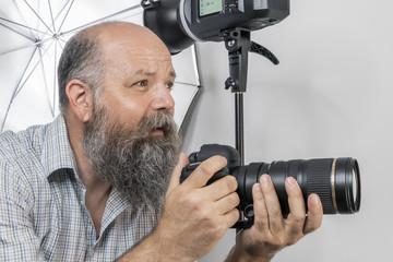bearded senior photographer at work