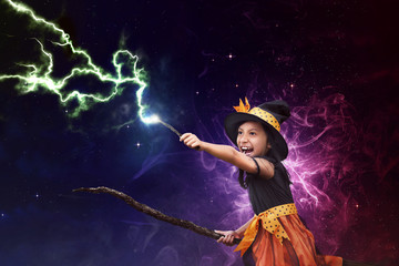 Asian witch girl with broomstick and magic wand