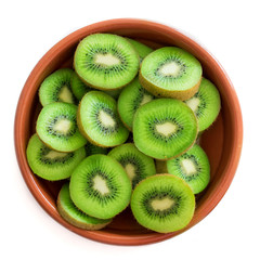 Halved Kiwi fruit in a bowl isolated on white  background. Top view.