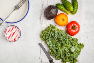Ingredients for a healthy salad on a white table, top view.  Healthy vegan food concept.