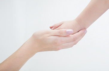 Mothers hand holding child hand on white background. Сoncept of care