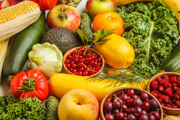 Colored fresh fruits, vegetables and berries. Clean eating concept, healthy food background.