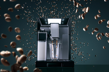 Coffee machine with flying coffee beans across it on dark background. Concept studio shooting. High speed freezing photo