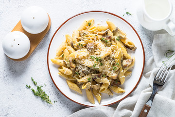 Pasta with white mushrooms in creamy sauce.