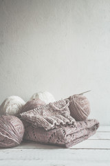 Tubes of wool thread and knitting needles for knitting handmade hobby in Scandinavian style monochrome with copy space
