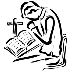 Bible with a cross on the table and a praying young man