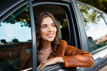 Fototapete - Beautiful woman sitting in her car