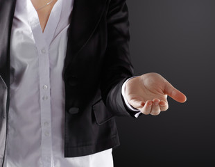close up. business woman with open palm .isolated on black background