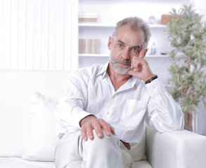 handsome businessman sitting on sofa in office.photo with copy space