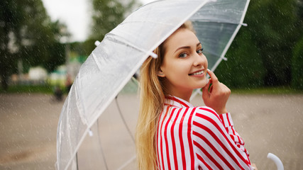 girl with transparent umbrella in rainy weather