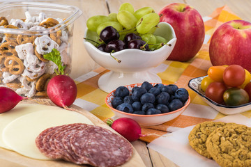 Preparation of school lunch. Cheese and salami, vegetables - ingredients for sandwiches.