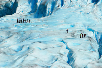 People hiking at the Jostedalsbreen glacier, the biggest glacier in continental Europe, located in Sogn og Fjordane county, Norway.