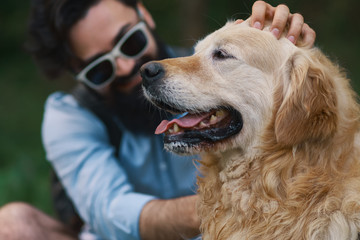 Dog and his owner - Cool dog and young man having fun