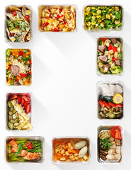 Frame made of healthy food boxes on white background