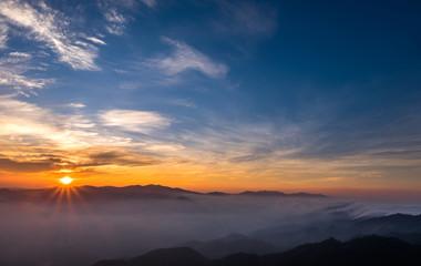 Scenic natural sunlight, sunrise orange, white mist flowed beautifully. Doi Phuwae at Nan in Thailand.
