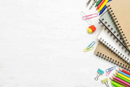 Top view back to school concept and education background concept. School supplies, stationery accessories on grunge white wood background. Flat lay, top view