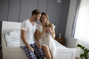 Loving couple in the bedroom