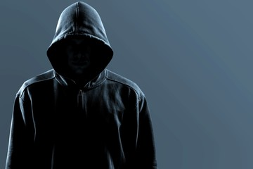 Thief in black clothes on grey background - fototapety na wymiar