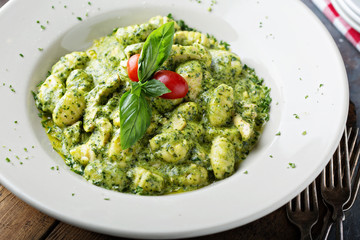 Freshly made gnocchi with pesto sauce