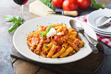 Rigatoni bolognese with fresh mozarella and basil