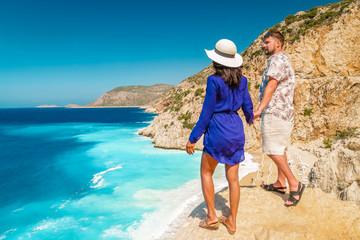 happy young couple man and woman on vacation at Kaputas beach Kas Turkey