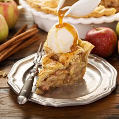 Homemade apple pie slice with vanilla ice cream