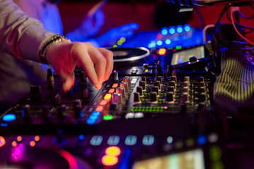 Professional sound mixer for musical events. hand of the DJ operator