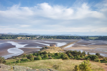 A photograph taken from Cramond Island of Cramond Beach at low tide and its surrounding nature close to Edinburgh, Scotland, United Kingdom.