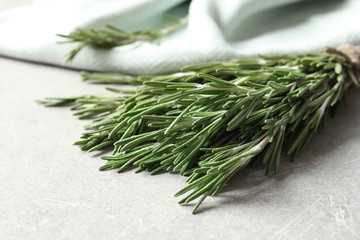 Fresh rosemary twigs on table, closeup
