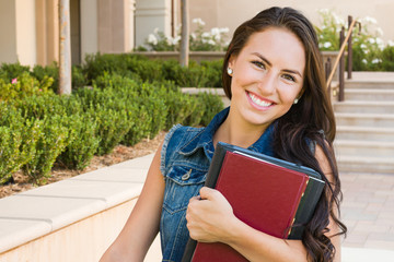 Mixed Race Young Girl Student with School Books On Campus