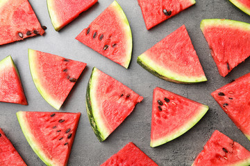 Flat lay composition with watermelon slices on grey background