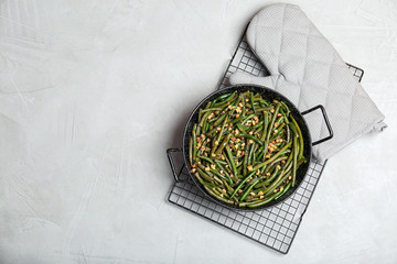Yummy green beans with almonds in dish on table