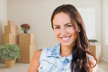 Mixed Race Young Girl Inside Empty Room wioth Moving Boxes