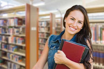 Mixed Race Young Girl Student with School Books Inside Library