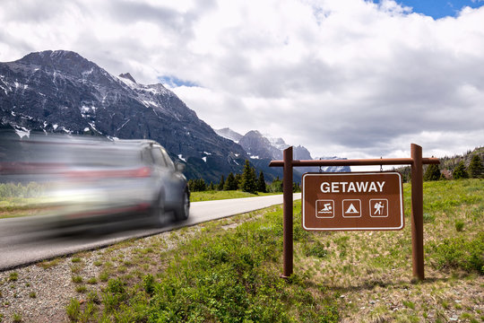 Car rushing to a weekend getaway in nature with mountains and park serenity