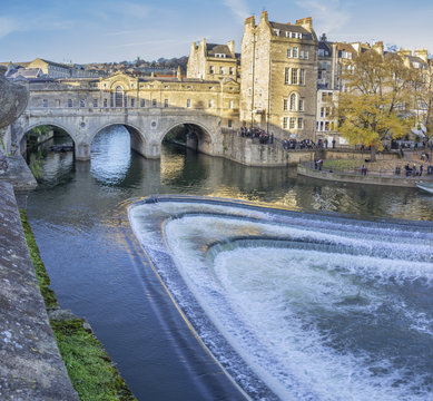 Pulteney bridge at Bath city inside the famous Cotswolds with River Avon waters crossing under the bridge during sunset. Bath, UK