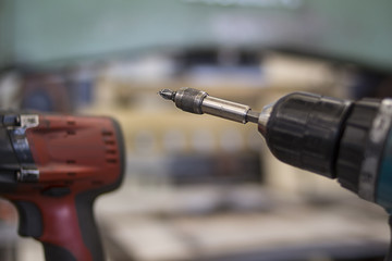 Electronic drill screwdriver with Phillips tip bit for standard industry construction work mechanical tasks or building jobs work site