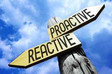 Proactive, reactive - wooden signpost