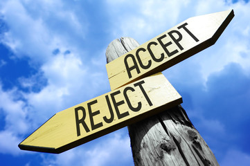 Accept, reject - wooden signpost